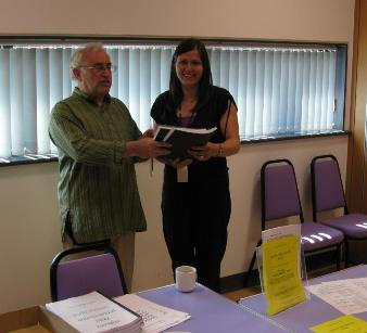 Jim Rayner presenting copies of his book to Hannah Quinlan